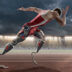 Physically Disabled Athlete Sprinting From Blocks With Artificial Robotic Legs